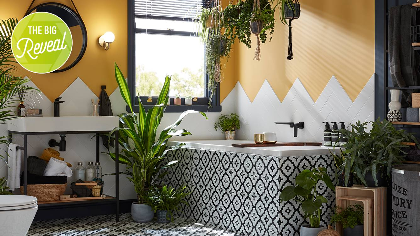 Renovated bathroom with yellow paint, plants and mosaic tilled finish