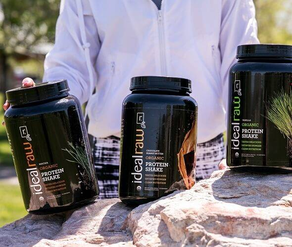 3 tubs of IdealRaw in a line on a rock
