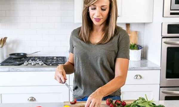 woman preparing fruit