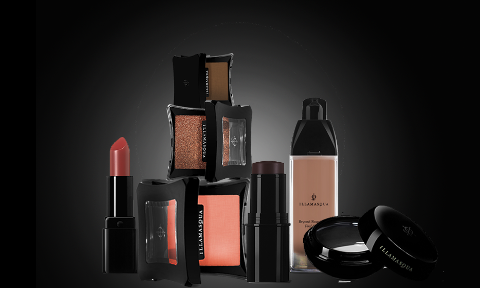 Lipstick, cream blusher, beyond foundation and hydra veil on a black background.