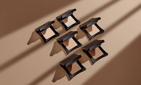 Skin Base Pressed Powders on tan background.
