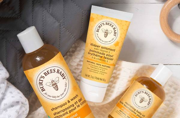 A bottle of Burt's Bees Baby Shampoo & Wash, Diaper Ointment and Nourishing Baby Oil
