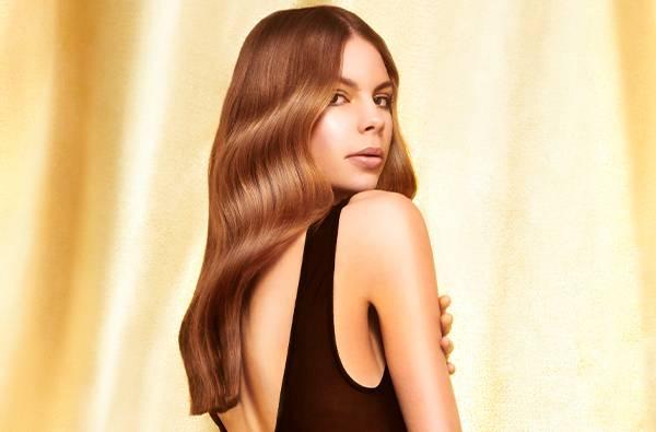 Fudge professional model on gold background