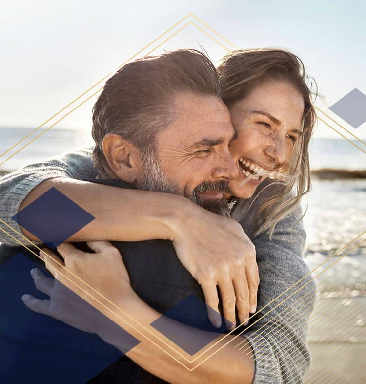 Man and women hugging and smiling