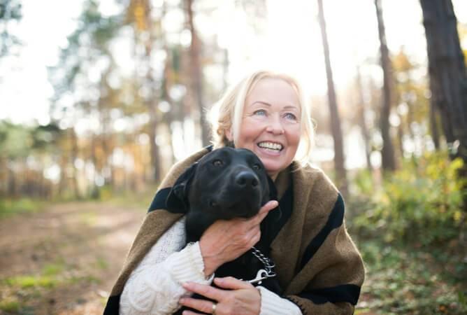 Women holding a dog