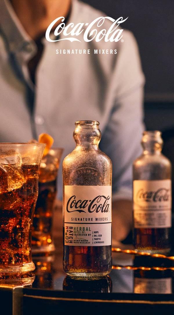 Coca-Cola Signature Mixers on a table