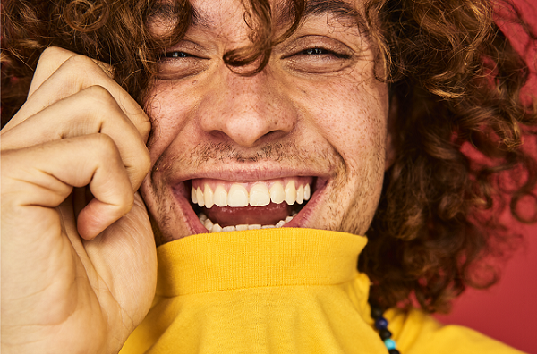 Man laughing with clear skin