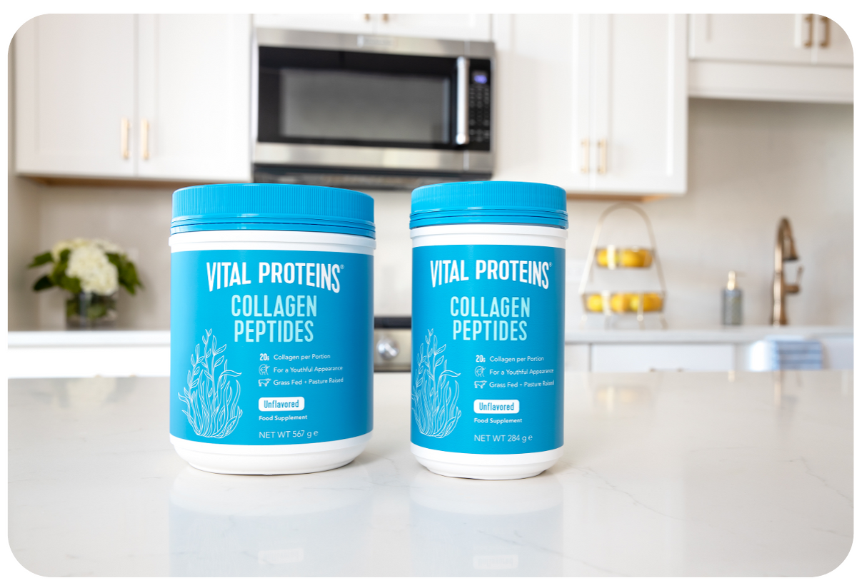 two tubs of collagen peptides powder on kitchen sideboard