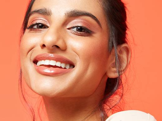 Model smiling wearing perfectly matched Note Cosmetics foundation