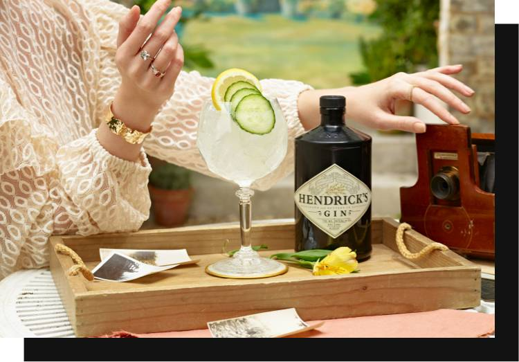 Hendricks Gin, prepared in a glass with cucumber and lemon.