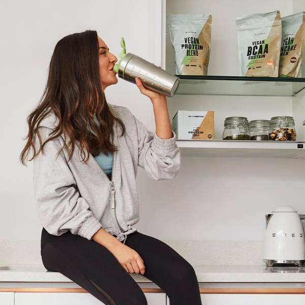 girl drinking vegan protein shake
