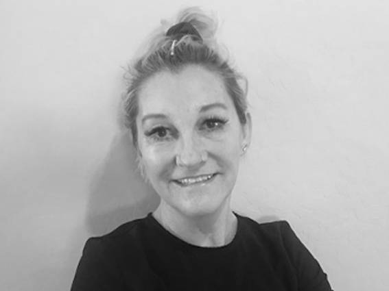 Sarah smiling, a reginol education manager