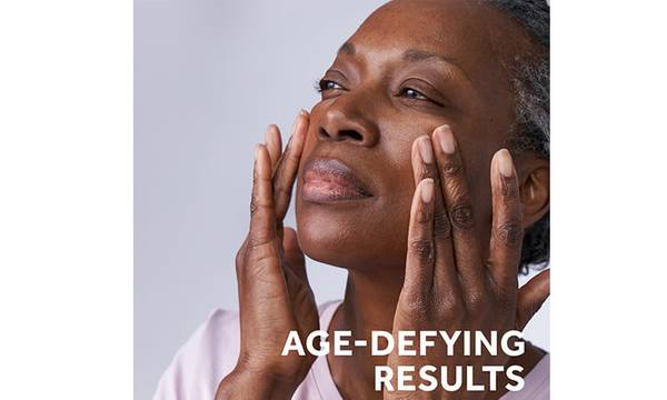 Woman applying Retinol product