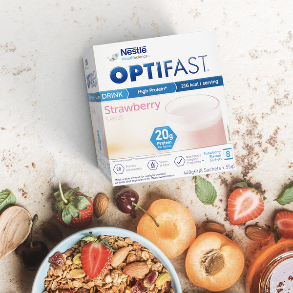 Box of OPTIFAST strawberry flavoured shake sachets on a kitchen counter