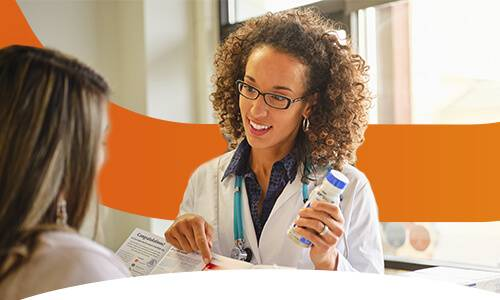 Image showing a medical professional showing someone Optifast products