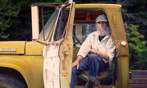 Burt smiling in a truck