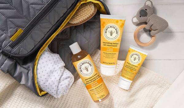 A bottle of Burt's Bees Baby Bee Shampoo & Wash, Nourishing Lotion and Diaper Ointment