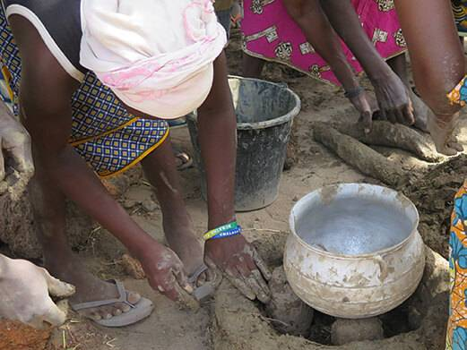 A woman learning how to cook on a carbon neutral stove