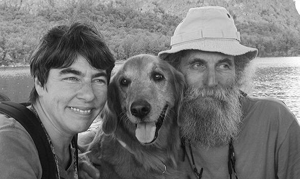 Burt & Roxanne on a boat with their dog