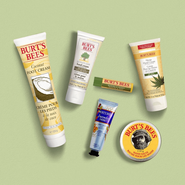 Burt's Bees Skin and Lip Care products on a green background, including Coconut Foot Cream, Hemp Hand Cream and Match & Honey Lip Balm