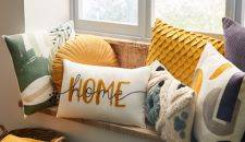 Cushions on a sofa with the word 'home' on it