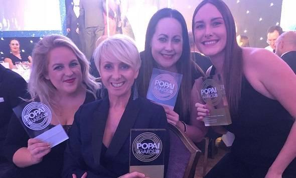 Revolution Beauty team holding POPAI Awards 2018