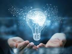 illuminating light bulb in hands