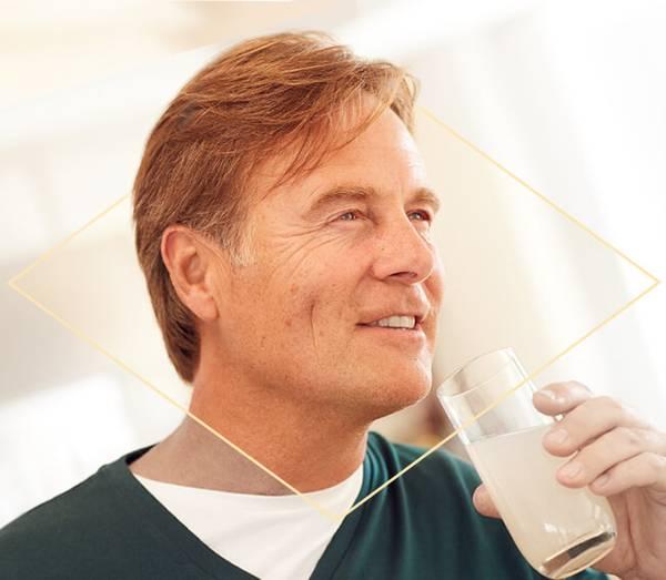 Man drinking a Celltrient sachet product