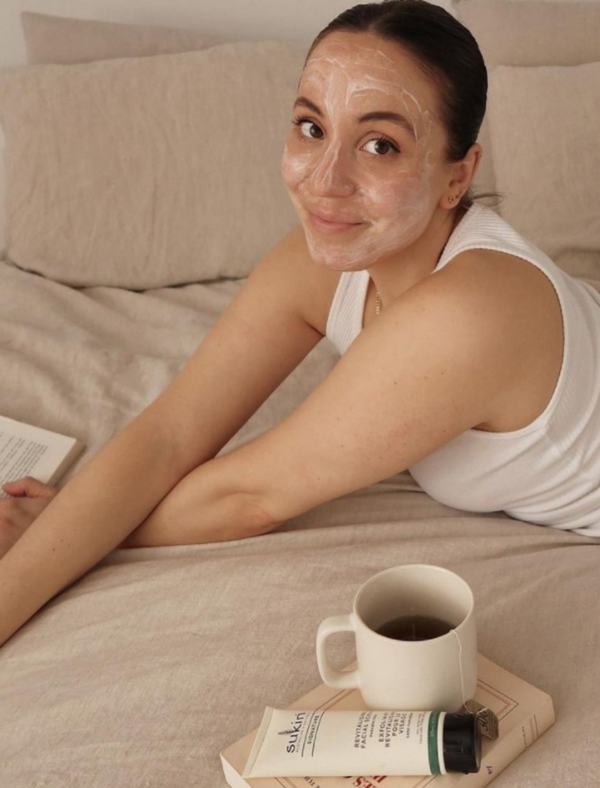 Girl lying down with Sukin Revitalising facial masque on her face. Visit @SukinSkincare Instagram