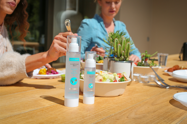 two women eating next to a spectriskin bottle. Visit our instagram