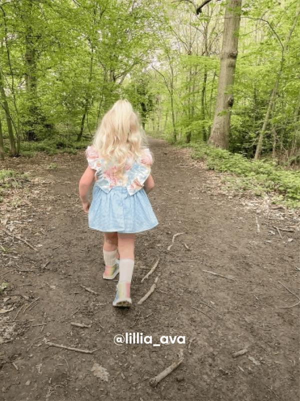 Girl Walking in the Grass - Visit Kickers Kids Instagram