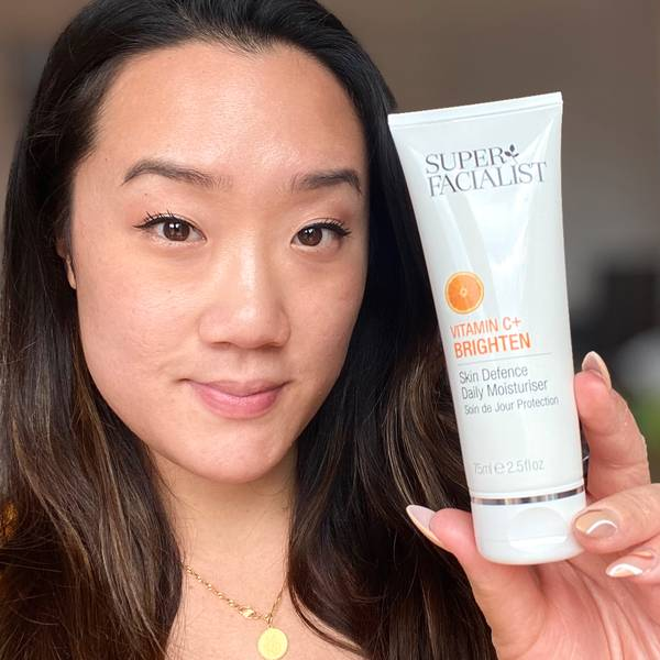 Woman holding Vitamin C+ Brighten Skin Defence Daily Moisturiser Visit Our Instagram