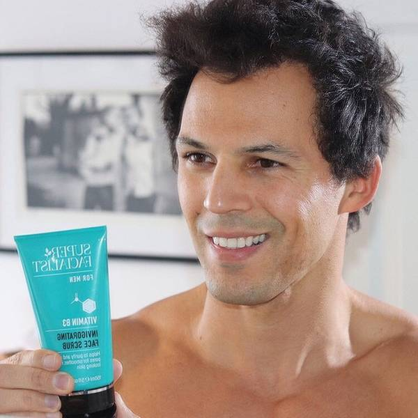 topless man holding super facialist for men invigorating face wash Visit Our Instagram