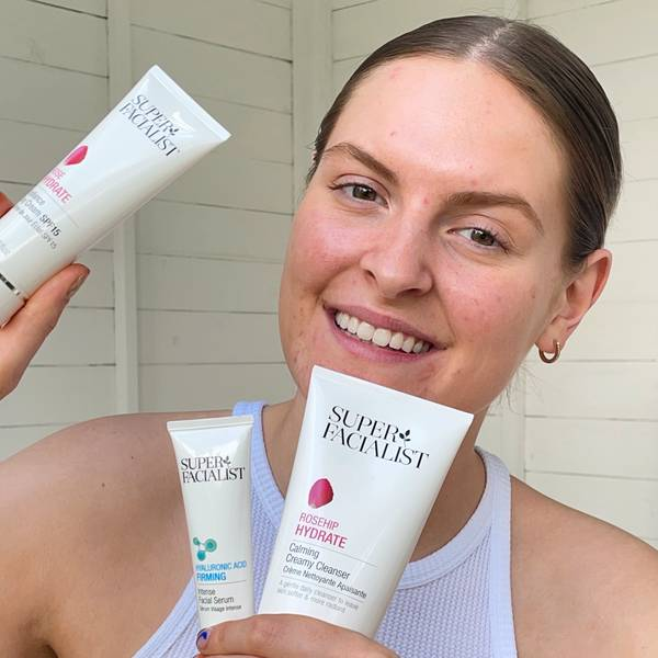 Woman holding rosehip hydrate product range and hyaluronic acid firming products. Visit Our Instagram