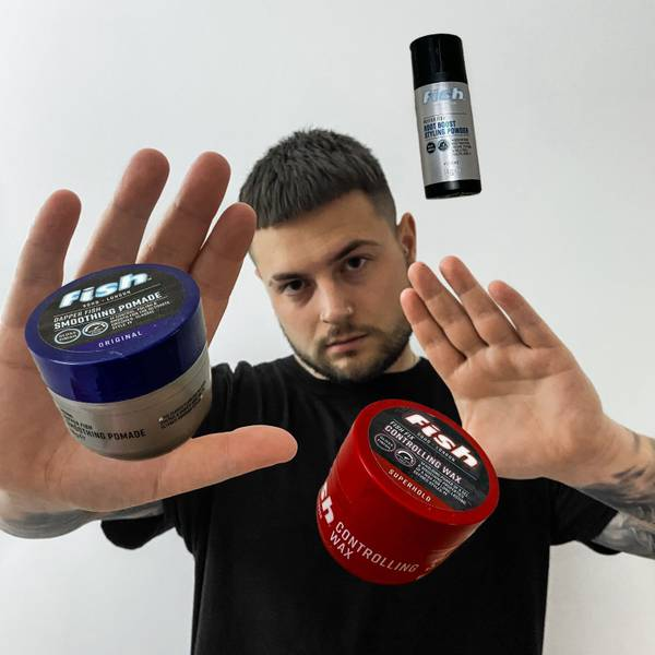 Man with both hands out levitating fish soho products Visit Our Instagram