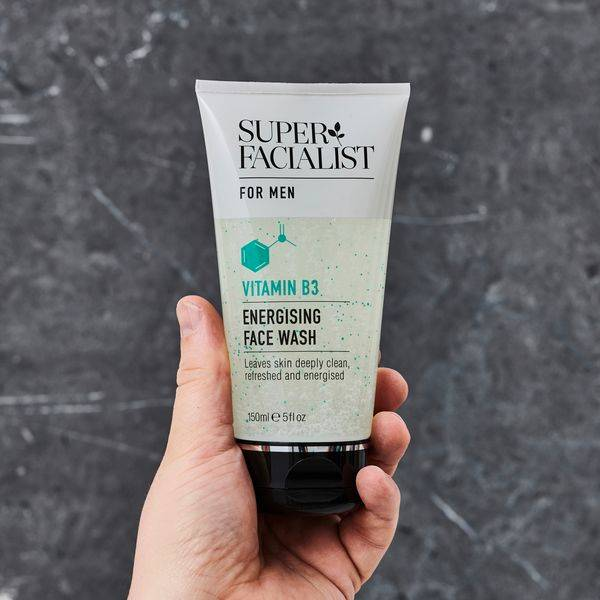 hand holding super facilalist for men Vitamin B energising face wash Visit Our Instagram