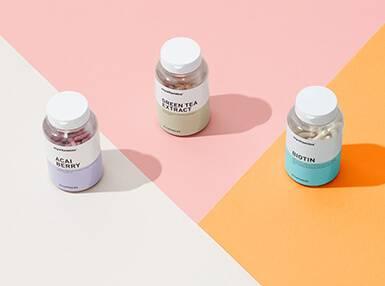 three bottles of vitamins
