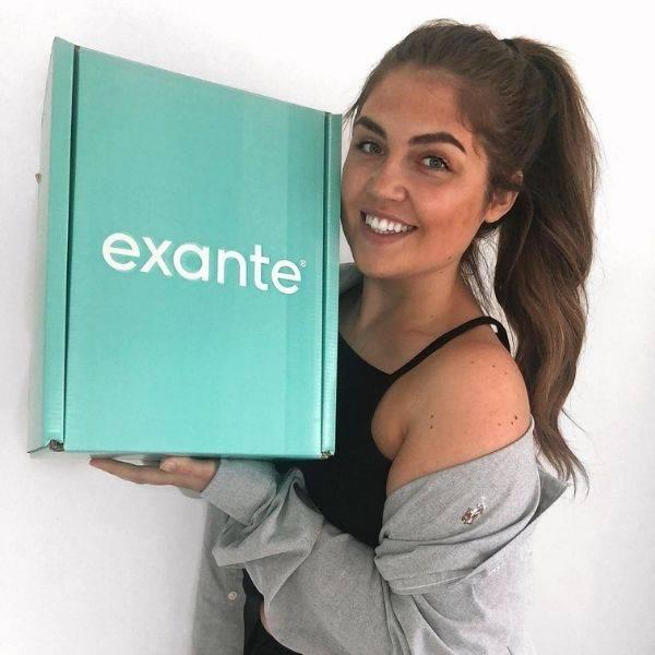 An influencer holding our 4 week diet box